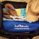 Portable travel beach umbrella fits neatly inside any suitcase